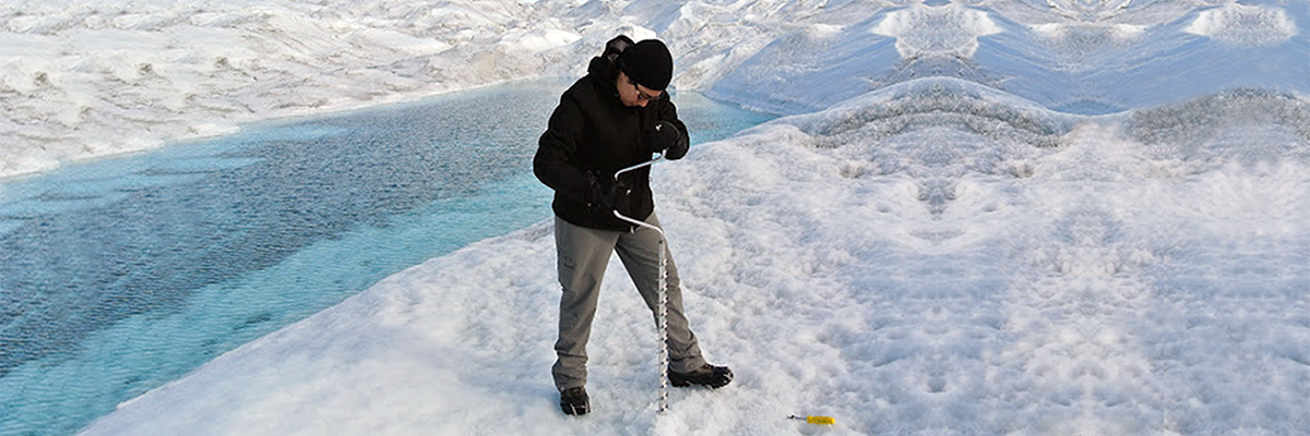 graduate student on ice in Greenland